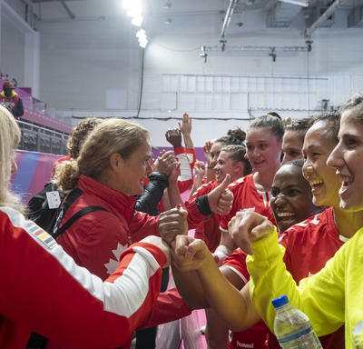 The Governor General gave the Canadian women's handball team high fives at the end of the game.