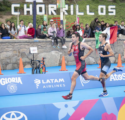 Canadian triathlete Charles Paquet is in the lead during a portion of the run.