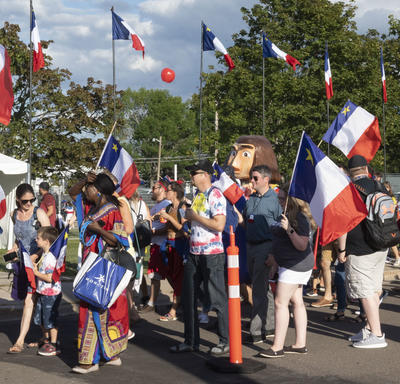 Acadians dressed in their national colours participated in the Tintamarre.