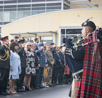 The Governor General, the Chief of the Defence Staff and guests in attendance stand and salute during the ceremony.