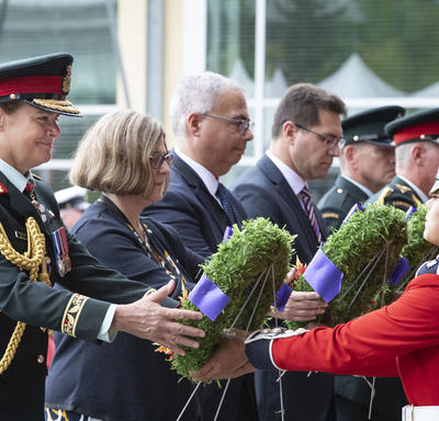 The Governor General prepares to lay a wreath at the Kandahar Cenotaph Rededication Ceremony.