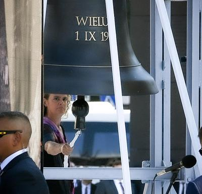 A photo of the Governor General ringing a bell at the commemorative ceremony.