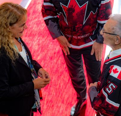 The Governor General speaks with Don White.