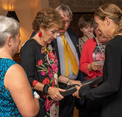 The Governor General hands a framed photo to Princess Margriet of the Netherlands.