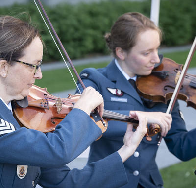 Canadian Armed Forces musicians play during an outdoor Order of Canada ceremony.