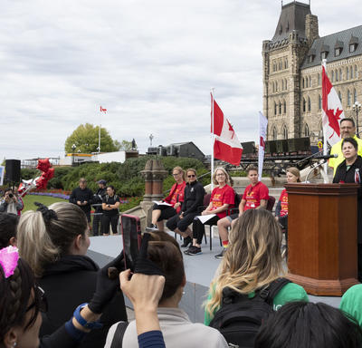 A photo of the Governor General and other special guests on stage delivering remarks.
