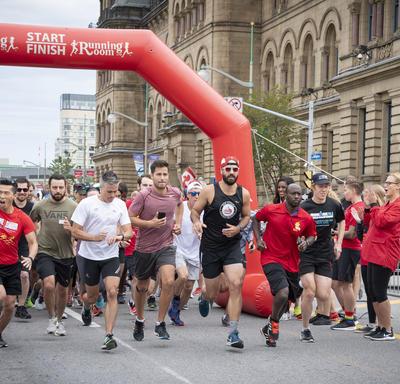 Runners at the starting line begin the GCWCC 5 km Walk Run Roll event.