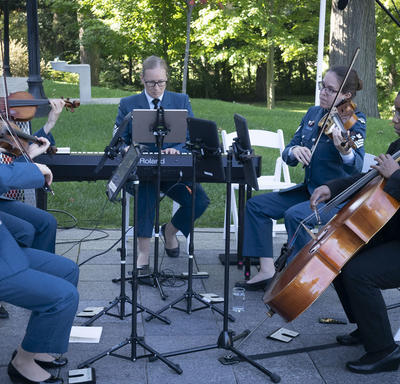 A photo of Canadian Armed Forces musicians playing during a Mixed Honours ceremony outside Rideau Hall.