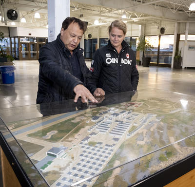 The Governor General and the mayor looking at a plan of Churchill.