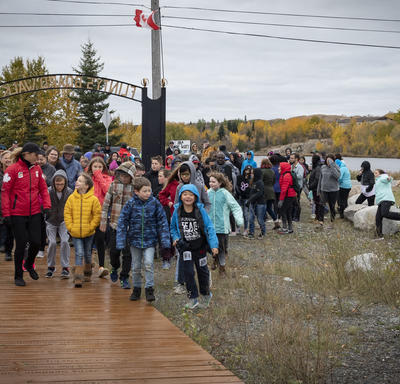Group of people walking with the Governor General.