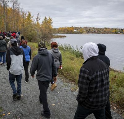Group of people walking around Ross Lake.