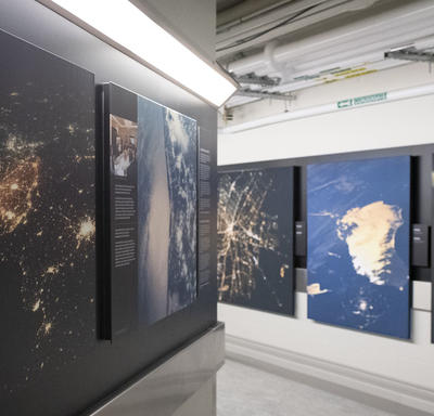 Display of photographs taken by astronauts.