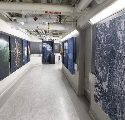 Display of photographs of Canadian provinces and territories taken by astronauts.