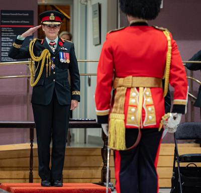 The Governor General salutes Lieutenant-Colonel Commanding Lynam of the Governor General's Foot Guards during a change of command ceremony.