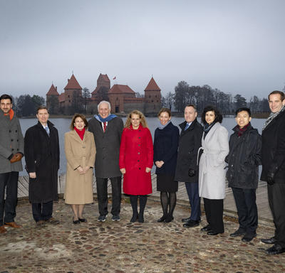 The Governor General and the Canadian delegation is posing for a photo in front of Trakai Castle.