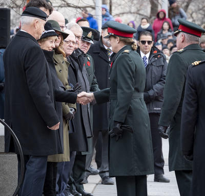 The Governor General shakes hands with the Silver Cross Mother during the National Remembrance Day Ceremony.