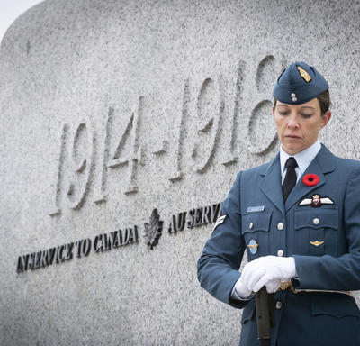 An officer stands solemnly by the monument during the National Remembrance Day Ceremony.