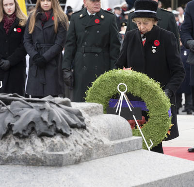 The Silver Cross Mother lays a wreath during the National Remembrance Day Ceremony.