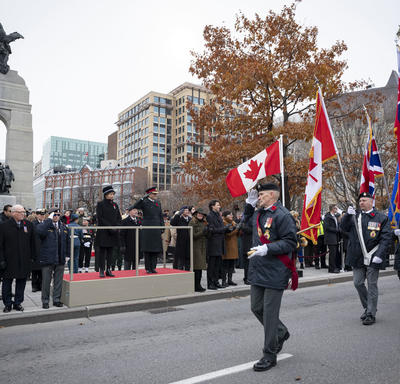 The Governor General salutes veterans as they march on.