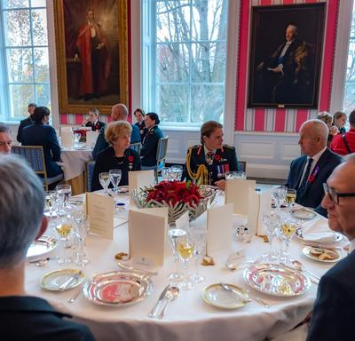 The Governor General sits and discusses with guests at the Luncheon for the National Silver Cross Mother.