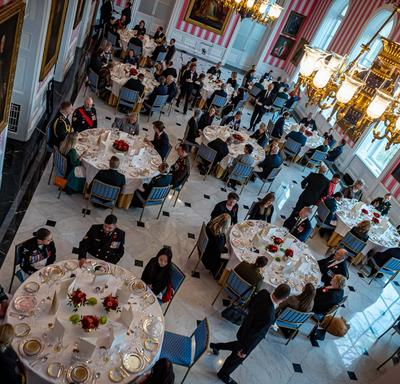 A photo from above of guests seated inside the Tent Room of Rideau Hall during the Luncheon for the National Silver Cross Mother.