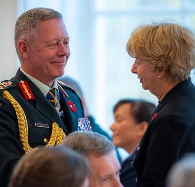 The Chief of the Defence Staff and the National Silver Cross Mother engage in conversation.
