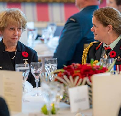 The Governor General and the National Silver Cross Mother sit together.