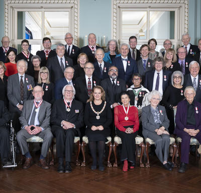 A group photo of the newly invested Order of Canada inductees.