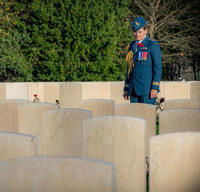 Governor General Julie Payette, wearing the Royal Canadian Air Force uniform, is seen from a distance, visiting the Cassino War Cemetery.