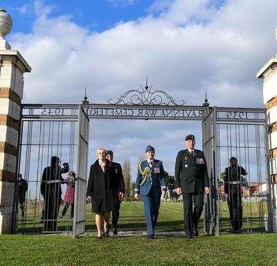 The Governor General enters the gates of the Ravenna War Cemetery.