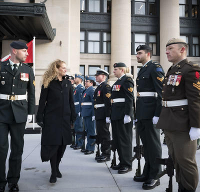 Upon arrival at the Senate of Canada Building, the Governor General inspected a guard of honour.