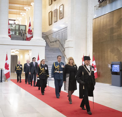 Led by the Usher of the Black Rod, officials, including the Governor General and Prime Minister, were processed into the chamber.