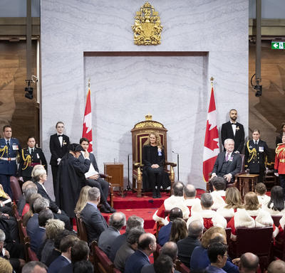 The Usher of the Black Rod addressed the Governor General.