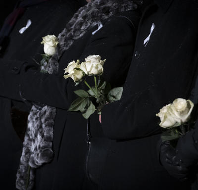 A photo of dignitaries holding white roses in honour of the 14 deceased women.