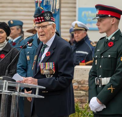 Canadian war veteran delivers remarks.