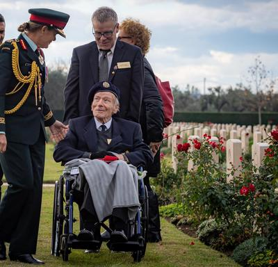 The Governor General speaks with a veteran.