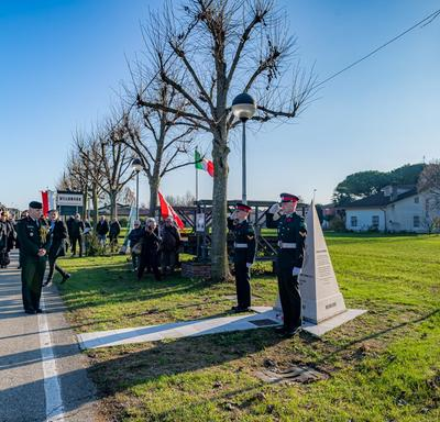 The Governor General stands in front of a monument at the Villanova Canadian War Cemetery.