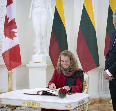 The Governor General signed the presidential guest book.