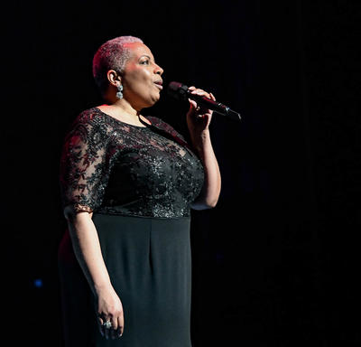 A singer is performing on stage.