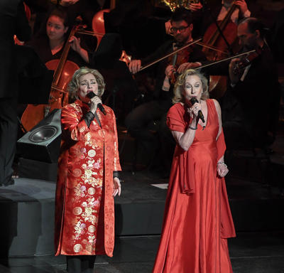 Two singers are performing on stage.