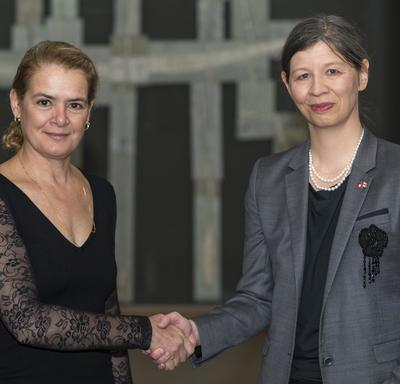 Her Excellency Salome Meyer, Ambassador of the Swiss Confederation, shakes hands with the Governor General.