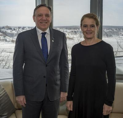 Quebec Premier François Legault and Canada's Governor General Julie Payette pose for a photo in front of a window of the Governor General's residence at La Citadelle. Winter view of the St. Lawrence River and the city of Lévis.
