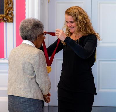 The Governor General gives a medal to Sylvia D. Hamilton.