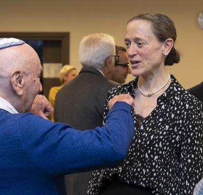 Leslie Scanlon, the Ambassador of Canada to Poland, speaks with a Holocaust survivor.