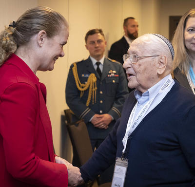 The Governor General chats with a Holocaust survivor.