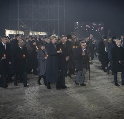 Survivors and world leaders walked with candles in their hands.