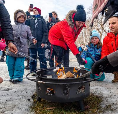 Visitors enjoyed warming up near the fire and eating S'mores. The activity was offered by the YMCA/YWCA.