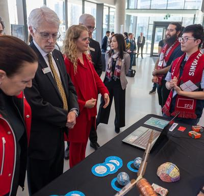 The Governor General meets with students from Simon Fraser University and hears about their projects.