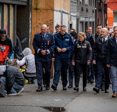 The Governor General walks with first responders in Vancouver.