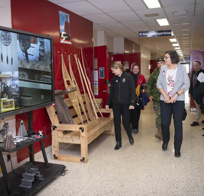 The Governor General walks down a hallway of Dennis Franklin Cromarty High School.